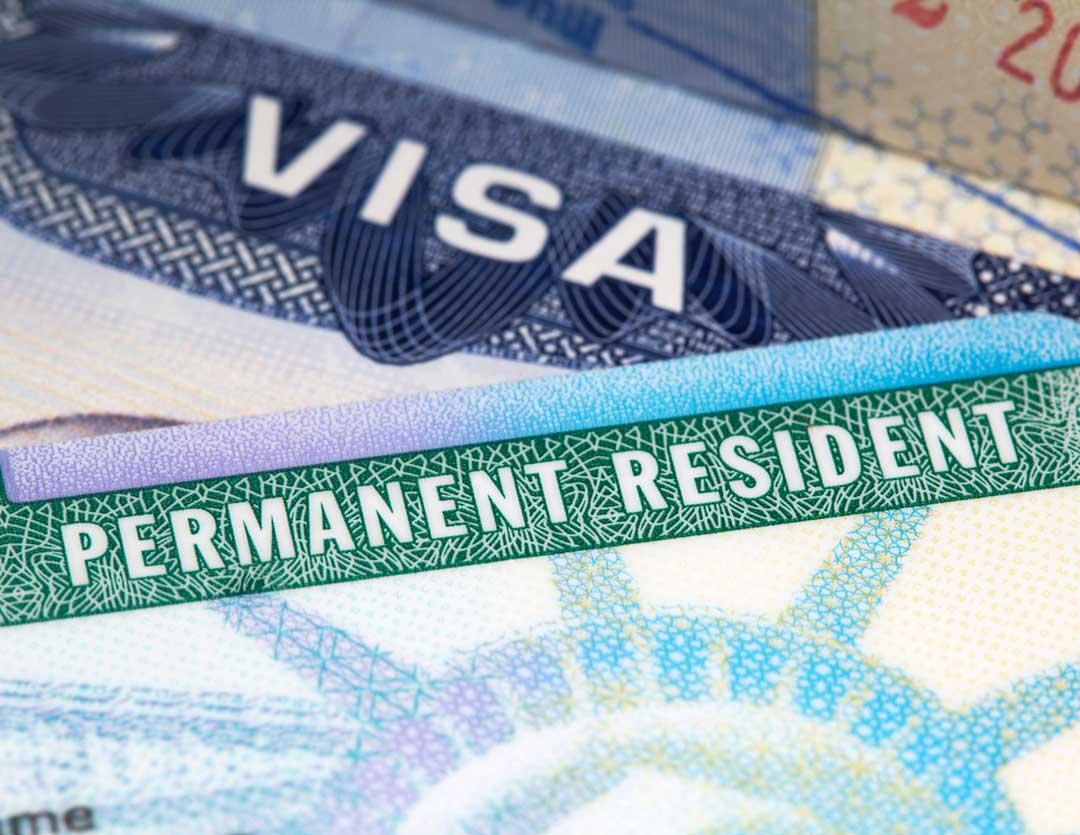 closeup of green card and visa